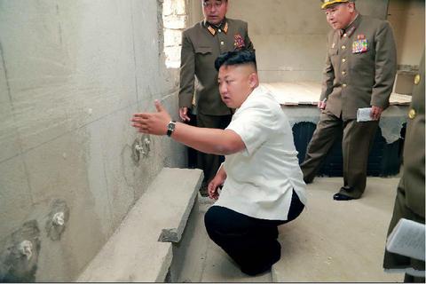 Kim Jong Un thi sat cong trinh xay dung hinh anh