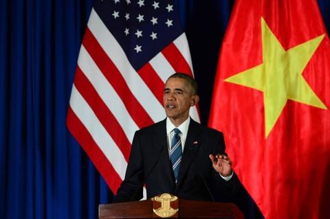 Mot ngay ban ron cua Tong thong Obama o Ha Noi hinh anh 10