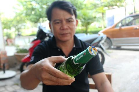 Chai bia Heineken co nap Tiger la hang that hay gia? hinh anh