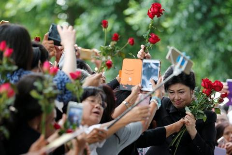 Hoa hong va nuoc mat: Yingluck toi phien toa ba co the bi ket an tu hinh anh 2