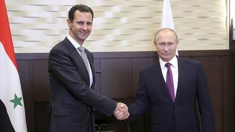Tong thong Putin: Nga sap ket thuc chien dich o Syria hinh anh