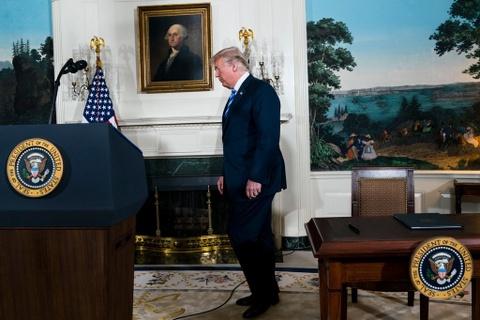 Xe bo thoa thuan Iran, Trump gui thong diep cung ran toi Trieu Tien hinh anh 1