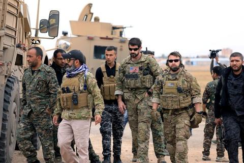 TT Trump tuyen bo chien thang IS, chuan bi rut quan khoi Syria hinh anh