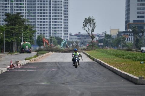 Tuyen duong thi cong cham hon rua bo qua khu do thi Tay Ho Tay hinh anh 9