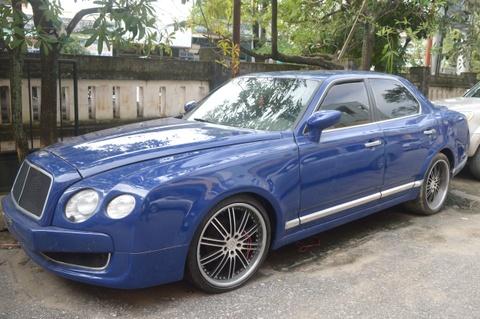 Quang Binh ban xe Bentley nhap lau gia 1,6 ty dong hinh anh