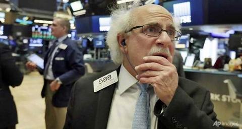 Dow Jones dao chieu sau 7 phien tang lien tiep hinh anh