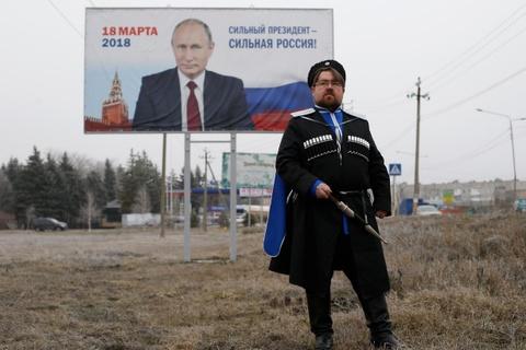 Bau cu tong thong Nga: Nguoi ton tho Putin, nguoi mong guong mat moi hinh anh 1