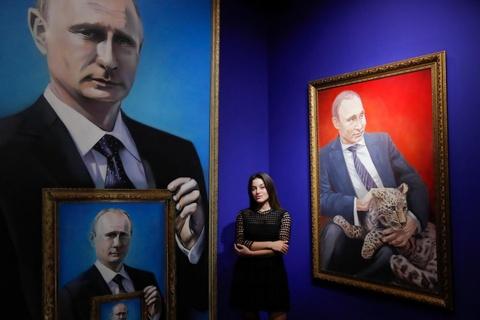Bau cu tong thong Nga: Nguoi ton tho Putin, nguoi mong guong mat moi hinh anh 3