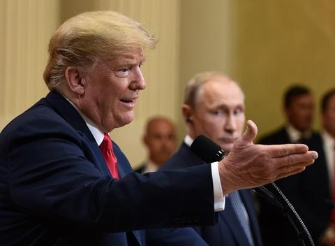 Bi phan doi, Trump hoan thuong dinh lan 2 voi Putin den nam sau hinh anh
