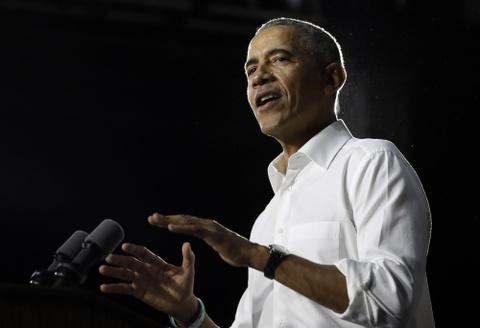 Obama - Trump doi dau gay gat truoc bau cu giua ky hinh anh 1