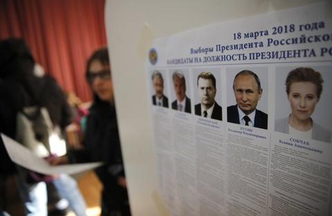 Bau cu Nga 2018: Tong thong Putin di bo phieu o Moscow hinh anh 6