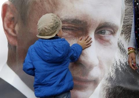 Hinh anh Tong thong Putin la bieu tuong trong cuoc song o Nga hinh anh