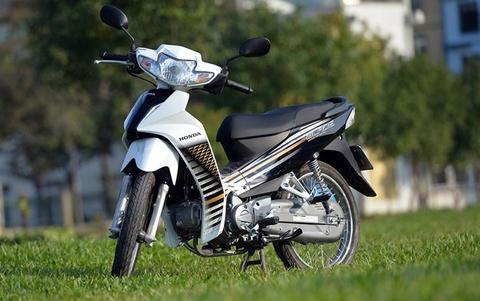 Honda, Yamaha cung tung chieu den xe mat cap o Viet Nam hinh anh
