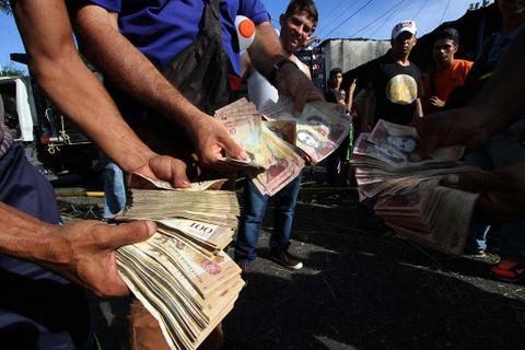 Lam phat o Venezuela: Dung bao tai thay cho vi, can tien thay vi dem hinh anh 14