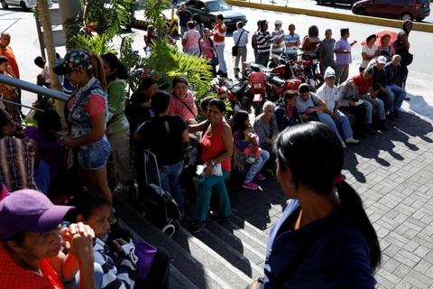 Lam phat o Venezuela: Dung bao tai thay cho vi, can tien thay vi dem hinh anh 4