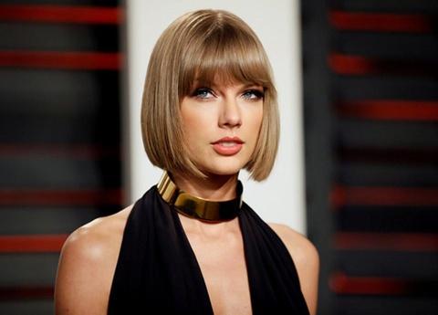 Taylor Swift bi kien vi su dung ten ung dung di dong trai phep hinh anh
