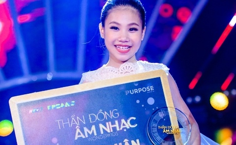 Co be 9 tuoi nhan giai thuong 1,5 ty dong cua Than dong am nhac hinh anh