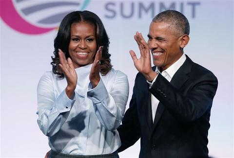 Su kien quang ba sach cua ba Michelle Obama tai chau Au chay ve hinh anh