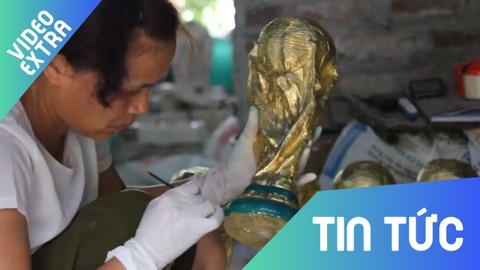Ben trong xuong lam 'cup vang World Cup' xuat sang Nga o Ha Noi hinh anh
