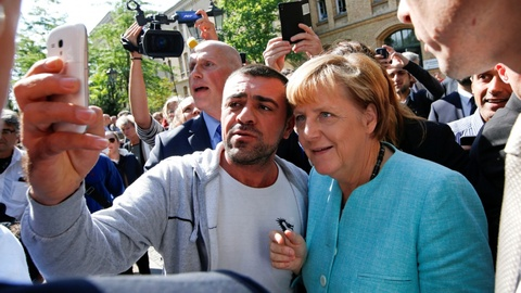 Tuong lai chinh tri Merkel lai trac tro vi van de nguoi ti nan hinh anh 3
