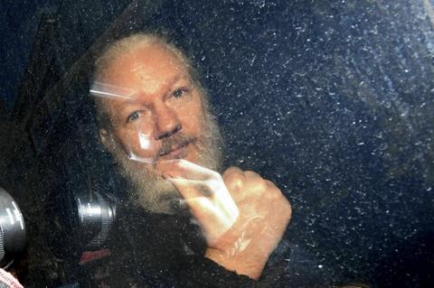 Ong trum WikiLeaks ket thuc 7 nam ti nan va su xau ho cua canh sat Anh hinh anh 1