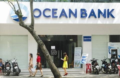 Ngan hang Nha nuoc co the mua lai Oceanbank va GPBank hinh anh