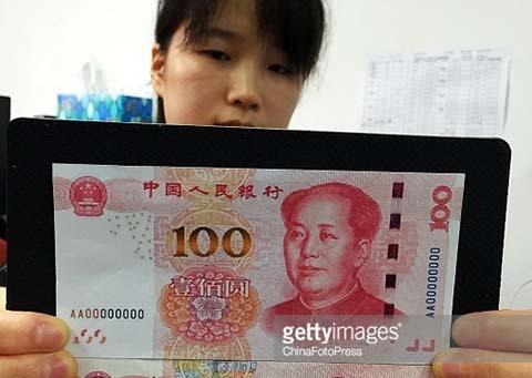 Lo ngai mat an ninh, Trung Quoc phat hanh dong 100 NDT moi hinh anh