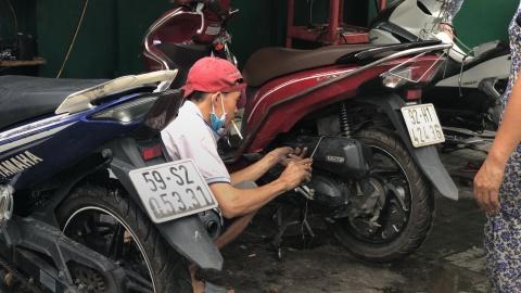 Nguoi Sai Gon ngu khach san qua dem, sang dat xe di sua hinh anh