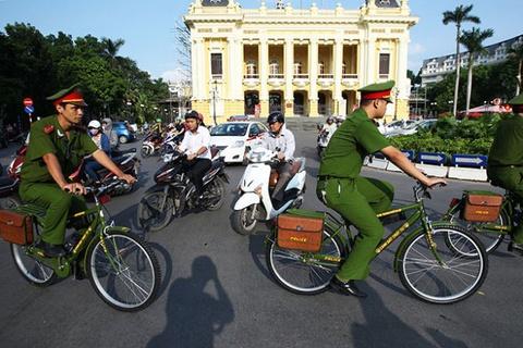 Tang cuong 1.000 xe dap cho cong an Ha Noi di tuan hinh anh