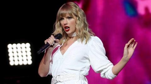 Nguoi mat viec o My tim den Taylor Swift, gioi ty phu de xin tien hinh anh