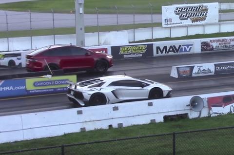 SUV dien cua Tesla dua thang Lamborghini Aventador SV hinh anh