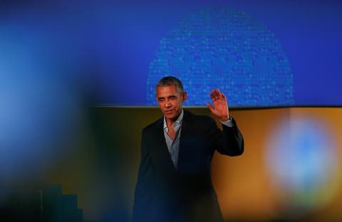 Obama xuat hien day phong cach o kinh do thoi trang Milan hinh anh 1