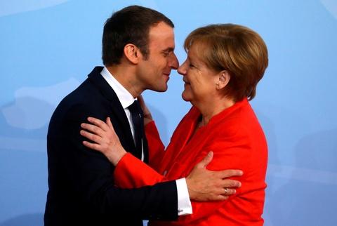 Thai do trai nguoc cua ba Merkel khi don ong Trudeau, Macron va Trump hinh anh