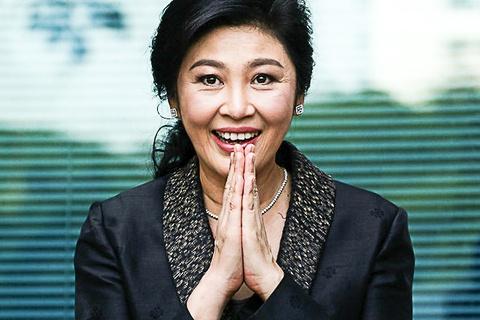 Dang Pheu Thai: Ba Yingluck da chay tron ra nuoc ngoai hinh anh