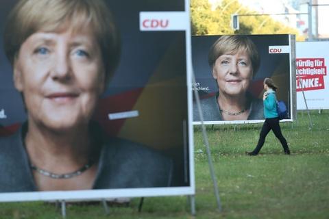 Trump va Merkel: Doi tac toan cau, nghin trung xa cach hinh anh 3