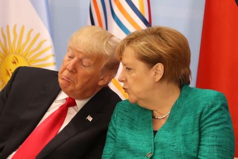 Trump va Merkel: Doi tac toan cau, nghin trung xa cach hinh anh 2