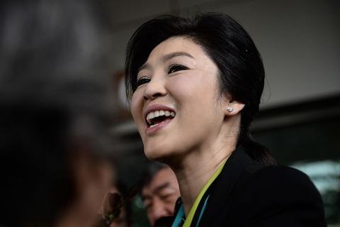 Anh em cuu thu tuong Yingluck xuat hien tai Singapore hinh anh
