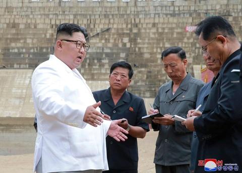 Kim Jong Un tap trung vao kinh te giua luc dam phan hat nhan be tac hinh anh
