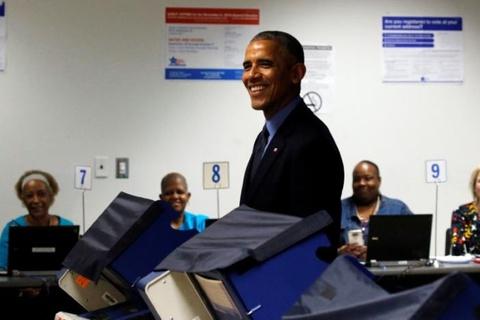 Ong Obama di bo phieu bau tong thong som hinh anh