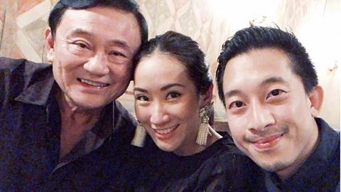 Tu Hong Kong va Singapore, Thaksin bay muu gianh lai anh huong hinh anh