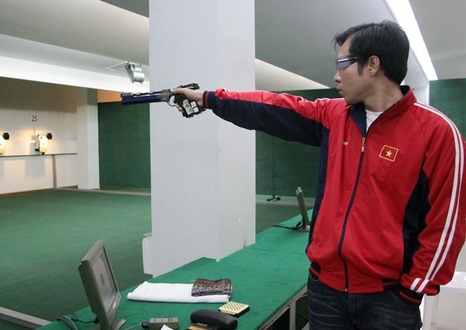 Hoang Xuan Vinh can nang van lap ky luc SEA Games hinh anh