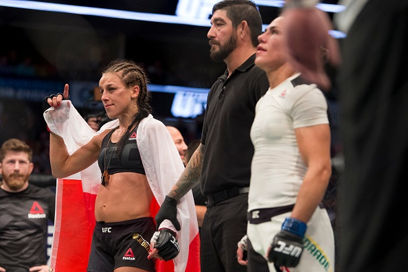 UFC 211: Mat 2 phut, nha vo dich cho ke thach dau do van hinh anh 12