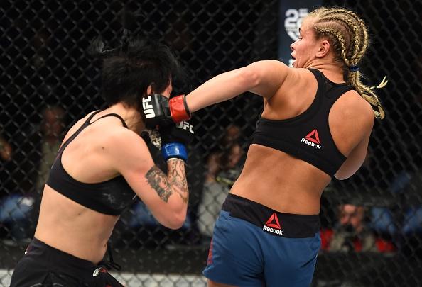UFC FN 124: Vo si quyen ru nhat UFC bi gay tay, thua tran thu 4 hinh anh 4