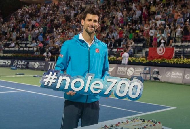 Djokovic chinh phuc cot moc 700 tran thang hinh anh 1