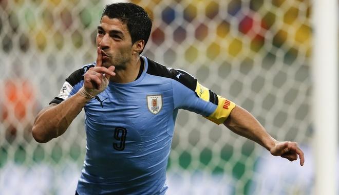 Luis Suarez va cau chuyen dang sau lop vo boc hinh anh