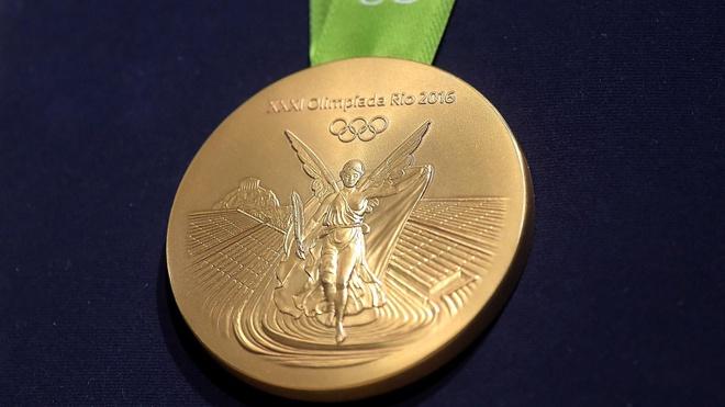 Vinh quang nao cho huy chuong vang Olympics? hinh anh 3