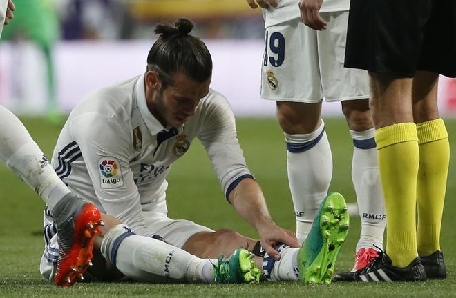 Gareth Bale dung phuong phap ky la chua chan thuong hinh anh