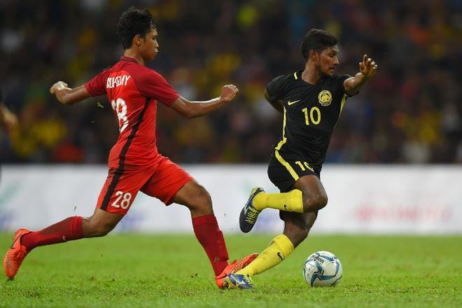 Ghi 2 ban trong 6 phut, U22 Malaysia nhan chim Singapore hinh anh 1
