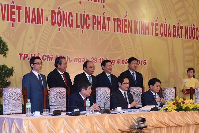 Ha Noi, TP HCM cam ket tao dieu kien thuan loi cho DN hinh anh