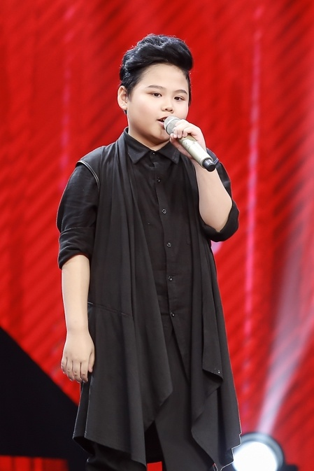 Co be hat Quoc ca gay nong mang xa hoi thi The Voice Kids hinh anh 9
